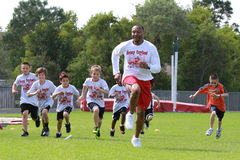 Horace Copeland. Retired NFL Tampa Bay Bucceneer's  Horace Hi-C Copeland runs drills with the campers at his second annual Football Camp on Friday March 23rd in Stock Image