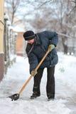 Horaire d'hiver, élimination de neige Photo stock