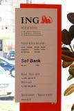 Horario del banco del uno mismo de ING Fotografía de archivo