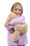 Horas de dormir - criança nos pijamas com urso de peluche Fotografia de Stock Royalty Free
