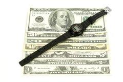 Horas e dólares Imagem de Stock