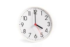 Horas en un fondo blanco Imagen de archivo libre de regalías