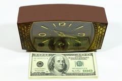 Horas y dólares Imagen de archivo libre de regalías