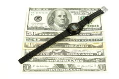 Horas y dólares Imagen de archivo