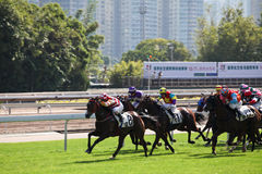 Horce Racing Day in Hong Kong. Horse racing happens twice a week in Hong Kong and is an excellent event for corporate functions and family gatherings Stock Photo