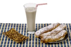 Horchata and fartons a traditional Spanish snack eaten in summer Royalty Free Stock Photos
