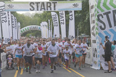 Horde of Color Runners Take Off Stock Photo