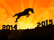 Hore jumps from year 2014 to new year 2015. A horse jumps from 2014 to 2015 Royalty Free Stock Images