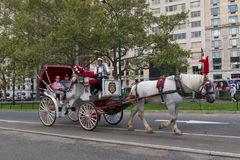 A Horese and Carriage Ride in New York City. New York, NY US --  August 31, 2016. Tourists go on a horse and carriage ride in New York City. Editorial Use Only Stock Photos