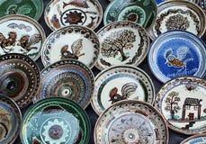 Horezu ceramic plates. Handmade ceramic plates from Horezu are on display at a fair in Bucharest, Romania, Saturday, 05 December 2015 Stock Photos