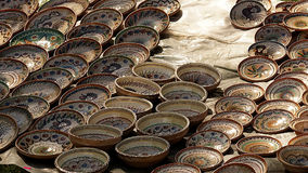Horezu pottery displayed at a traditional handicraft fair. Horezu pottery is a distinctive jevel in the Romanian traditional handicraft. The beauty of the Royalty Free Stock Image