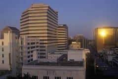 Horisont av Austin, TX, statlig capitol på solnedgången Royaltyfria Bilder