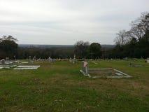Horisont - träkors i en kyrkogård Montgomery AL arkivfoton