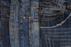 Horisontal denim background, assortment of  jeans. Horisontal denim background, assortment of blue jeans Royalty Free Stock Photo