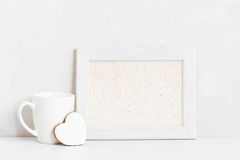Horisontal empty white wooden frame. Cup and cookie on the white background Royalty Free Stock Images