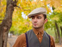 Horisontal portrait young man in hat. In the autumn park Stock Photo