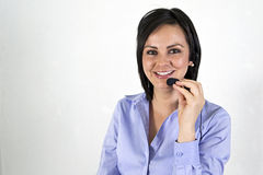 Executive Woman with headset smiling Stock Image
