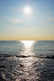 Horizon. Sun leaving a trail on the water Royalty Free Stock Images