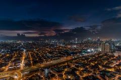 Horizon de Manille de métro au coucher du soleil Images libres de droits