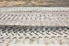 Horizon of Equipment Tracks in Sand Work Area royalty free stock photo