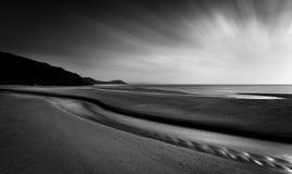 Horizon Highlights and sunrays, Pentewan Sands, Cornwall stock photography