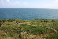 Horizon on the ocean, cork county, ireland. This is view from the top of cliffs, great sunny weather, three steps - rocky earth, cold water and the fresh air Royalty Free Stock Photo