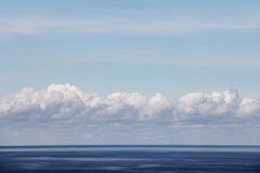 Horizon over water. Blue ocean and bright sky with beautiful clouds Stock Photos