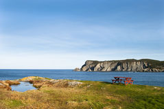 Horizon Picnic. Coastline view showing Picnic Table, Cliffs and Horizon Royalty Free Stock Image