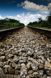 Into the horizon. Railway track horizon perspective in daylight Stock Images