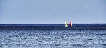 Horizon with sailboats Stock Images