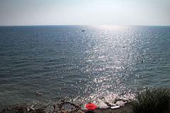 The horizon and the sea. Beautiful glare from the sun on the water Stock Photos