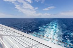Abstract horizon of ocean water behind a cruise ship royalty free stock photography