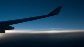 Horizon with wing tip. Jet airplane wing tip with horizon beneath Stock Photo