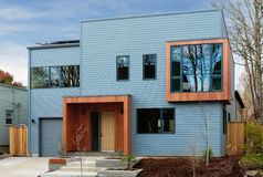 Horizonal shot of a modern, upscale home with blue sky royalty free stock image