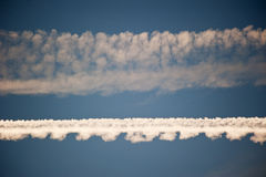 Horizondal aircraft trails in the sky Royalty Free Stock Photo
