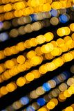 Horizontal abstract defocused bokeh illuminated garland view fro. Abstract defocused bokeh illuminated garland view from below in central city square decoration royalty free stock images