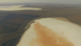 Horizontal aerial panorama of Koyashskoe pink salt lake in Crimea. Russia stock footage