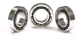 Horizontal arrangement of three ball bearings. Isolated on white background Stock Images
