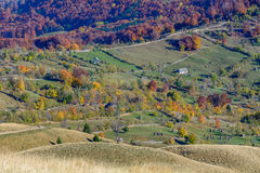 Horizontal autumn mountain landscape with stacks, animals, fence Stock Photos