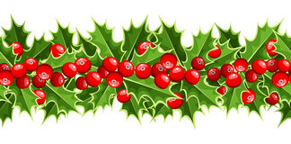 Horizontal background with Christmas holly. Royalty Free Stock Photo