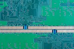 Horizontal background of the computer Board with tracks and contacts. Memory close-up green royalty free stock photography