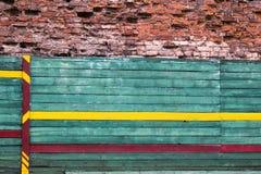 Horizontal background cracked bricks and board Stock Photos