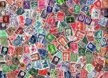 Horizontal background of European postage stamps. EUROPE - circa 1950-2000: Horizontal background of definitive European postage stamps, including stamps from Stock Photos