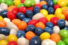 Horizontal Background Made Of Multi-coloured Sweets With Raisin Stock Images