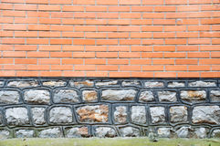 Horizontal background with stone and red brick facade Stock Images