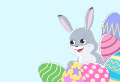 Horizontal background for text with a picture of a rabbit and colored Easter eggs. Royalty Free Stock Photo