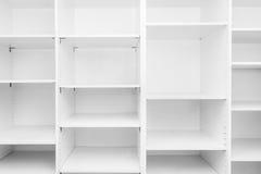 Emty white shelf. Horizontal background with various empty white shelves Stock Photography