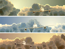 Horizontal banner of plane among clouds. Stock Photo
