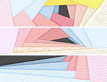 Horizontal banners lined and squared colored paper lie on each o Stock Photos