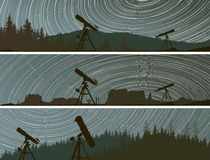 Horizontal banners of stars trace circles on the sky over the fo Stock Images